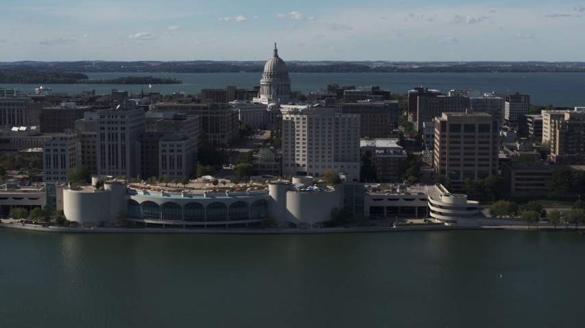 5.7K stock footage aerial video of passing the convention center with capitol and office buildings in background, Madison, Wisconsin Aerial Stock Footage | DX0002_160_010