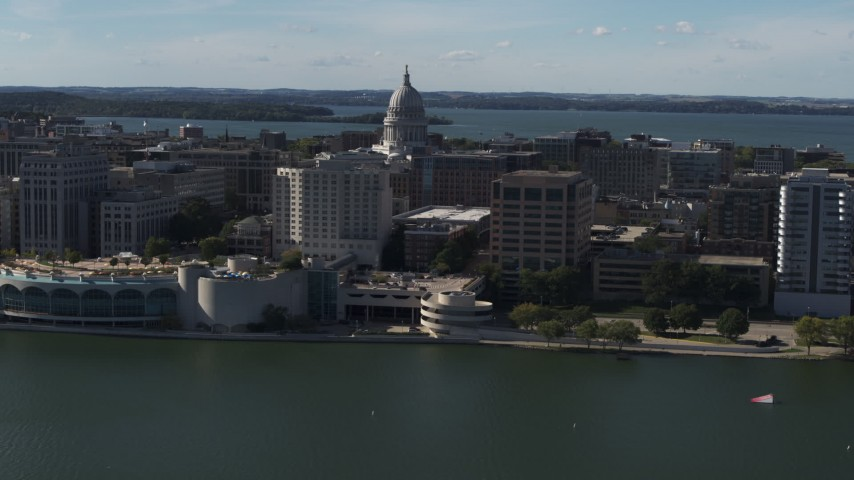 5.7K stock footage aerial video of a reverse view of the convention center with capitol and office buildings in background, Madison, Wisconsin Aerial Stock Footage | DX0002_160_011