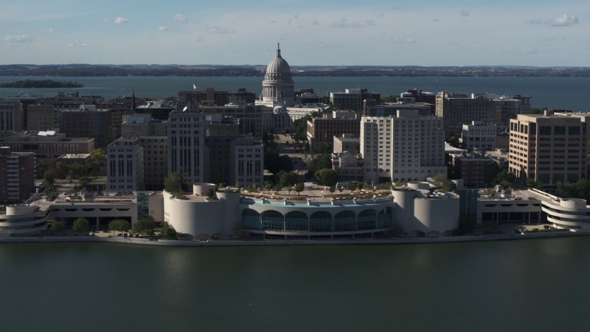 5.7K stock footage aerial video of slowly passing the convention center with capitol and office buildings in background, Madison, Wisconsin Aerial Stock Footage | DX0002_160_012