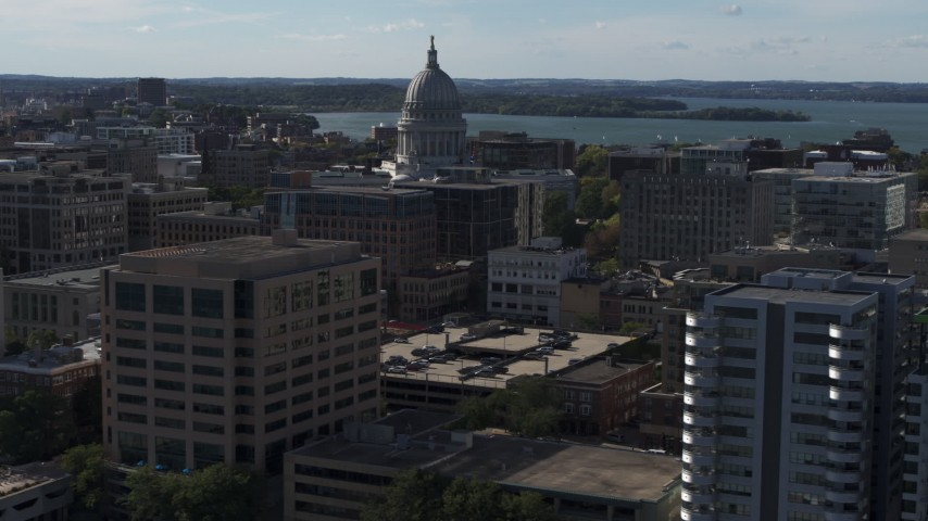 5.7K stock footage aerial video focus on capitol and flyby office buildings, Madison, Wisconsin Aerial Stock Footage | DX0002_160_014