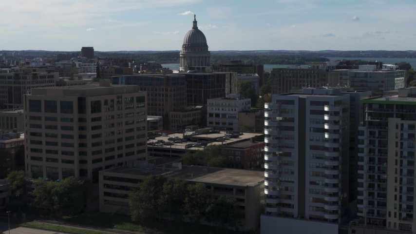 5.7K stock footage aerial video focus on capitol and pass by office buildings, Madison, Wisconsin Aerial Stock Footage | DX0002_160_015
