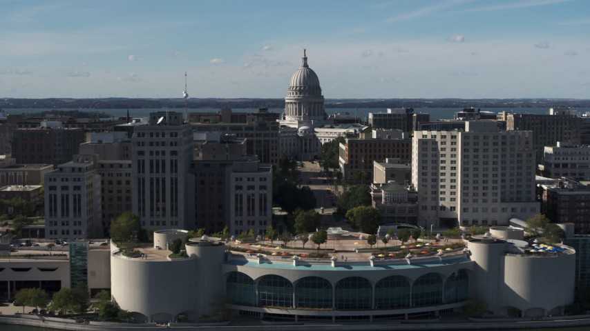 5.7K stock footage aerial video pass by office buildings and focus on the capitol building in Madison, Wisconsin Aerial Stock Footage DX0002_160_017 | Axiom Images