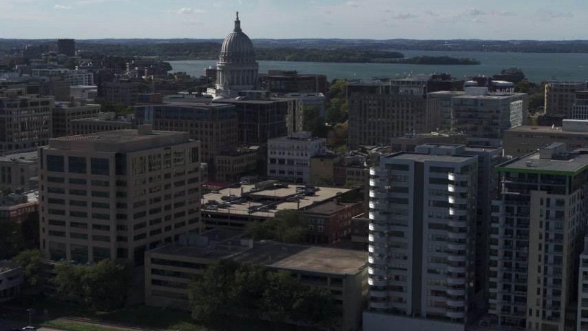 5.7K stock footage aerial video fly near office buildings and focus on the capitol building in Madison, Wisconsin Aerial Stock Footage | DX0002_160_019