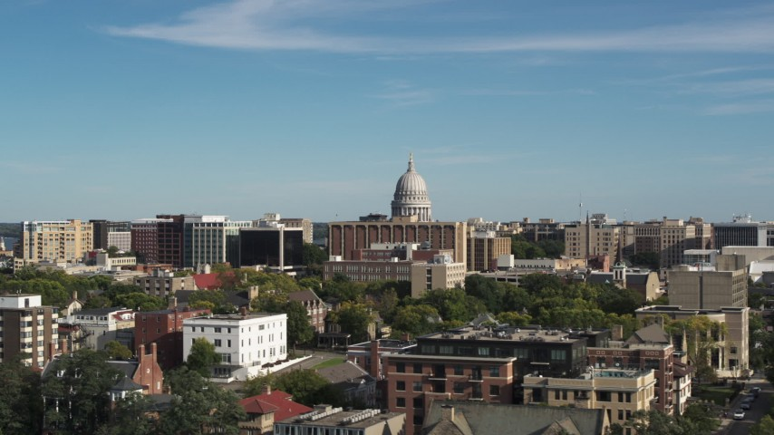 5.7K stock footage aerial video of ascending near apartment buildings for view of the capitol building in Madison, Wisconsin Aerial Stock Footage | DX0002_160_020