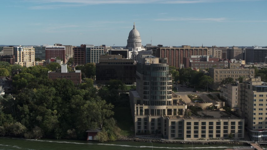 5.7K stock footage aerial video focus on the capitol dome and reveal hotel in Madison, Wisconsin Aerial Stock Footage | DX0002_160_023