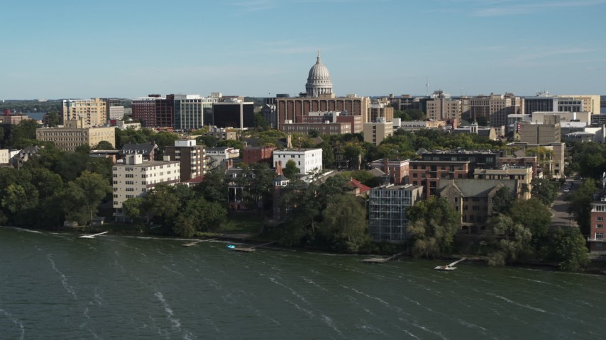 5.7K stock footage aerial video focus on the capitol dome while passing lakeside apartment buildings in Madison, Wisconsin Aerial Stock Footage | DX0002_160_025