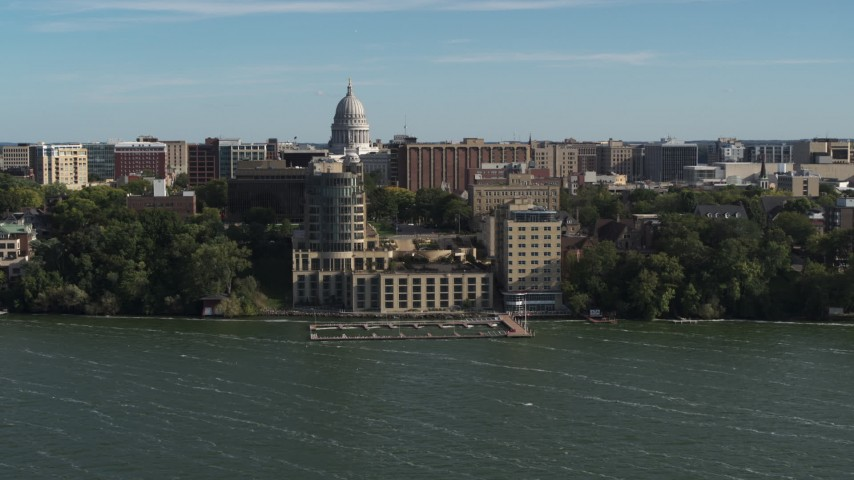 5.7K stock footage aerial video approach a lakeside hotel in Madison, Wisconsin with capitol dome in background Aerial Stock Footage | DX0002_160_028