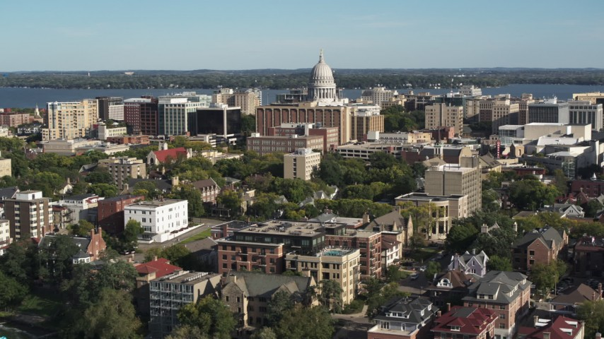 5.7K stock footage aerial video reverse view of the capitol dome from lakeside apartment buildings in Madison, Wisconsin Aerial Stock Footage | DX0002_160_029