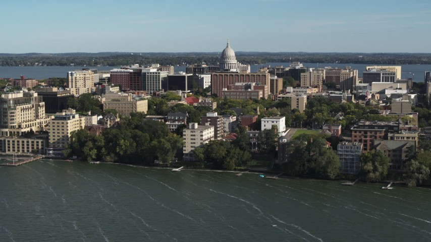 5.7K stock footage aerial video approach the capitol dome and lakeside apartment buildings in Madison, Wisconsin Aerial Stock Footage | DX0002_160_031