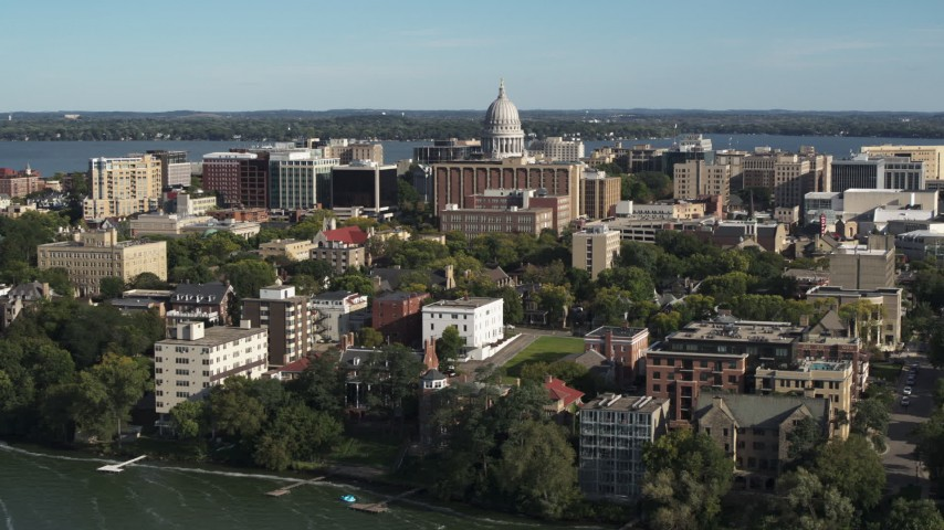 5.7K stock footage aerial video fly toward the capitol dome from lakeside apartment buildings in Madison, Wisconsin Aerial Stock Footage | DX0002_160_032
