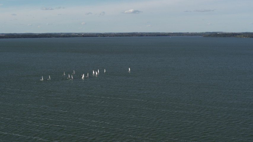 5.7K stock footage aerial video of a group of sailboats on Lake Mendota, Madison, Wisconsin Aerial Stock Footage | DX0002_160_034