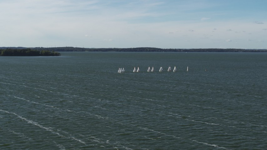 5.7K stock footage aerial video of a reverse view of a group of sailboats on Lake Mendota, Madison, Wisconsin Aerial Stock Footage | DX0002_160_035