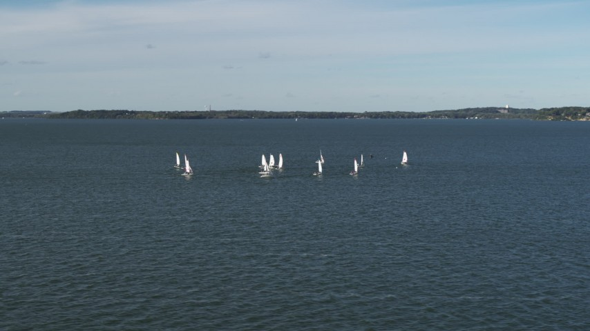 5.7K stock footage aerial video of circling a group of sailboats on Lake Mendota, Madison, Wisconsin Aerial Stock Footage | DX0002_160_037
