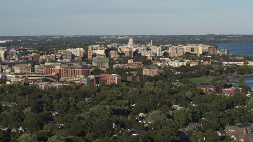 5.7K stock footage aerial video a stationary view of the capitol dome from a residential neighborhood, Madison, Wisconsin Aerial Stock Footage | DX0002_161_002