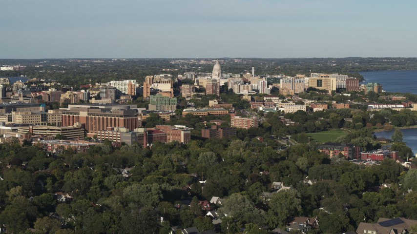 5.7K stock footage aerial video of the capitol dome and downtown seen from a residential neighborhood, Madison, Wisconsin Aerial Stock Footage | DX0002_161_003
