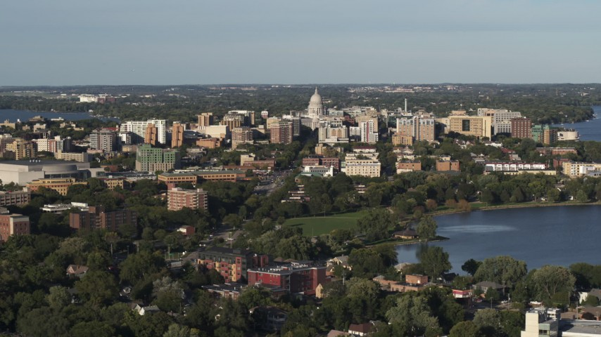 5.7K stock footage aerial video wide view of the capitol dome and downtown seen from a residential neighborhood, Madison, Wisconsin Aerial Stock Footage | DX0002_161_004