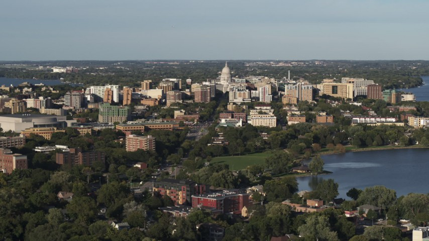 5.7K stock footage aerial video flying by the capitol dome and downtown seen from a residential neighborhood, Madison, Wisconsin Aerial Stock Footage | DX0002_161_005