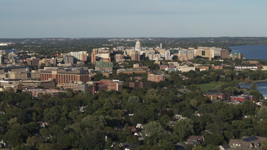 5.7K stock footage aerial video fly away from and by the capitol dome and downtown seen from homes, Madison, Wisconsin Aerial Stock Footage | DX0002_161_006