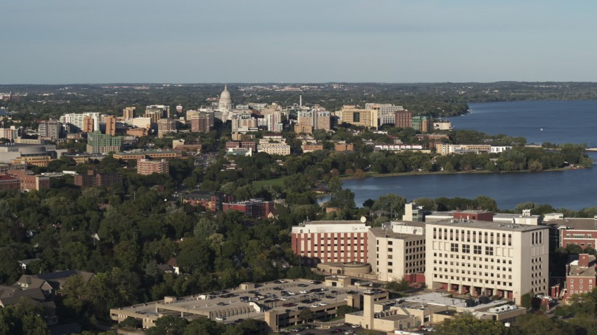 5.7K stock footage aerial video of the capitol dome and downtown seen from hospital, Madison, Wisconsin Aerial Stock Footage | DX0002_161_007
