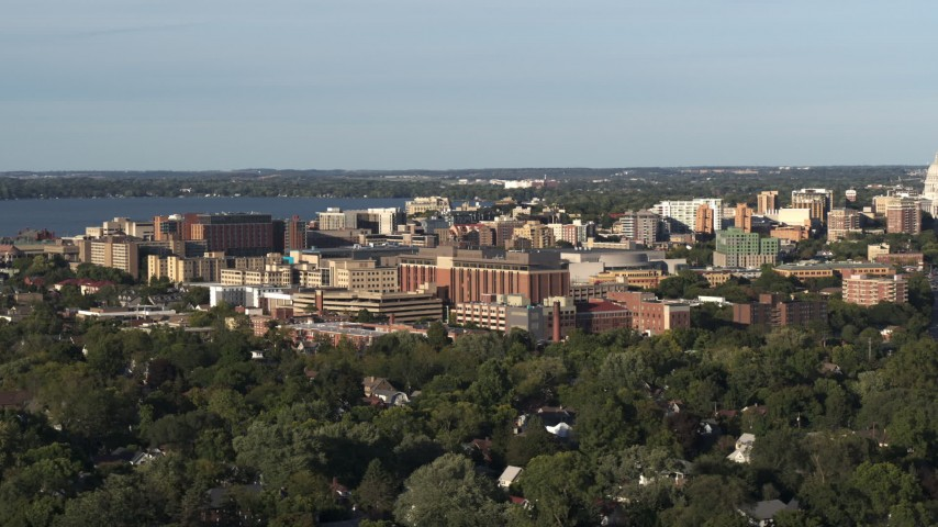 5.7K stock footage aerial video of orbiting a hospital near downtown during ascent, Madison, Wisconsin Aerial Stock Footage | DX0002_161_013