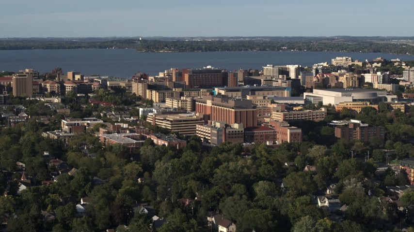 5.7K stock footage aerial video of a reverse view of a hospital near downtown, Madison, Wisconsin Aerial Stock Footage | DX0002_161_014