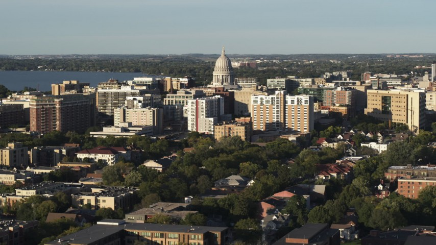 5.7K stock footage aerial video ascend and flyby the capitol dome and downtown buildings, Madison, Wisconsin Aerial Stock Footage | DX0002_161_019