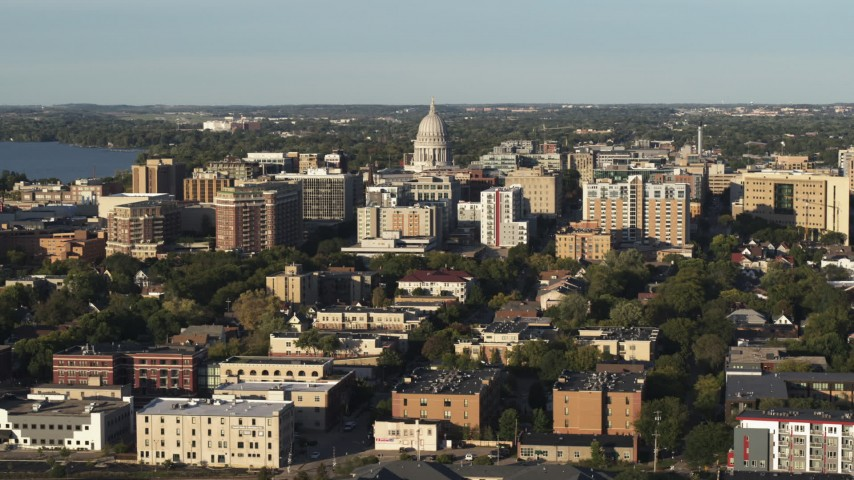 5.7K stock footage aerial video flying past the capitol dome and downtown buildings, Madison, Wisconsin Aerial Stock Footage | DX0002_161_021