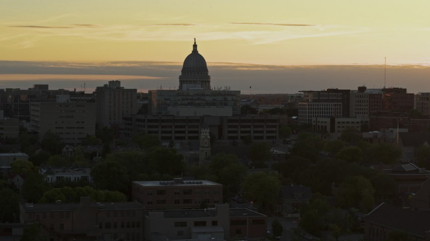 5.7K stock footage aerial video ascend toward the capitol dome at sunset, Madison, Wisconsin Aerial Stock Footage | DX0002_161_025
