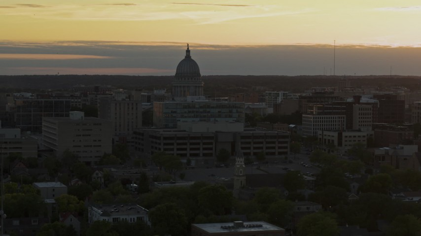 5.7K stock footage aerial video of a reverse view of the capitol dome at sunset, Madison, Wisconsin Aerial Stock Footage | DX0002_161_026
