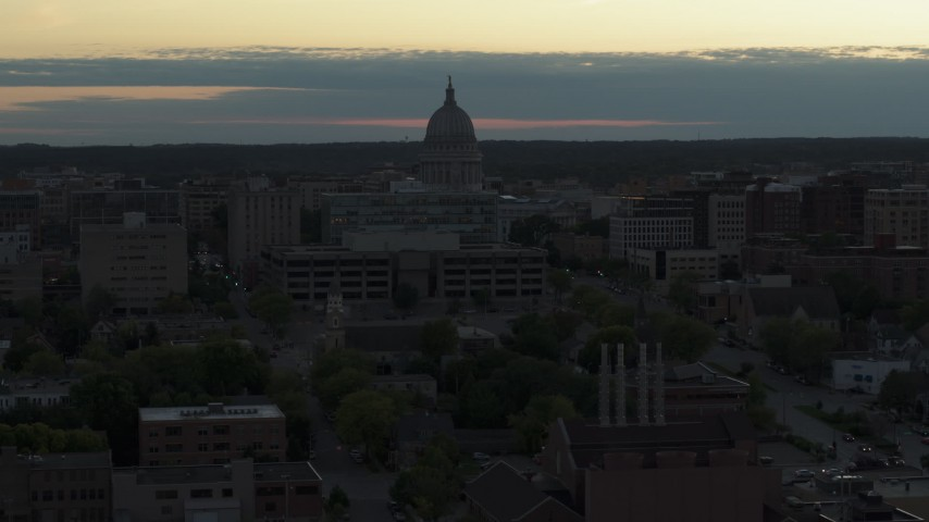 5.7K stock footage aerial video of flying away from the capitol dome at sunset, Madison, Wisconsin Aerial Stock Footage | DX0002_162_001