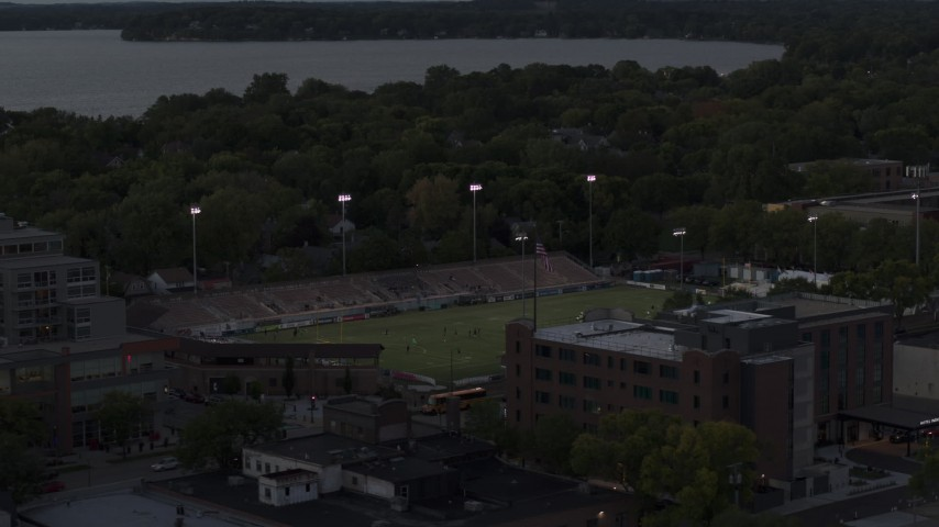 5.7K stock footage aerial video of orbiting a soccer stadium at twilight, Madison, Wisconsin Aerial Stock Footage | DX0002_162_009