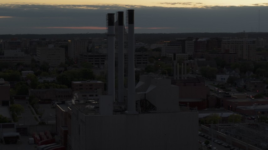 5.7K stock footage aerial video of approach and orbit power plant smoke stacks at twilight, Madison, Wisconsin Aerial Stock Footage | DX0002_162_010