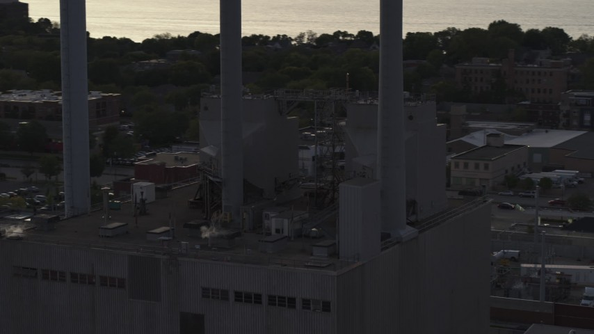 5.7K stock footage aerial video orbit smoke stacks at a power plant at twilight, Madison, Wisconsin Aerial Stock Footage | DX0002_162_012