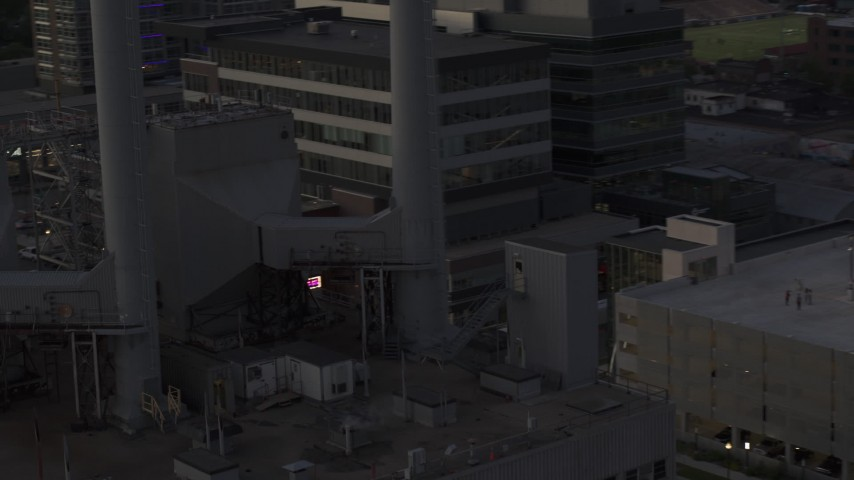 5.7K stock footage aerial video close orbit of smoke stacks at a power plant at twilight, Madison, Wisconsin Aerial Stock Footage | DX0002_162_013