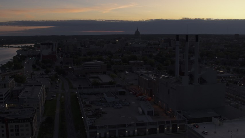 5.7K stock footage aerial video the capitol dome seen from near power plant smoke stacks at twilight, Madison, Wisconsin Aerial Stock Footage | DX0002_162_016