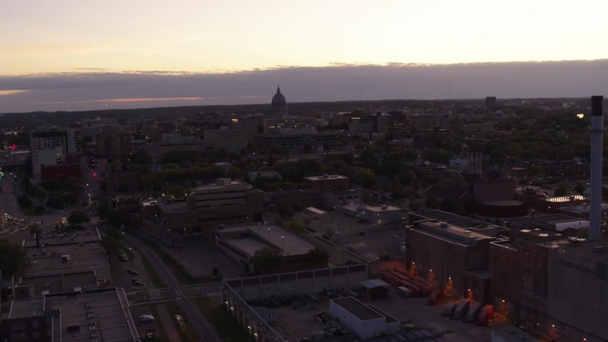 5.7K stock footage aerial video approach capitol dome from power plant smoke stacks at twilight, Madison, Wisconsin Aerial Stock Footage | DX0002_162_019