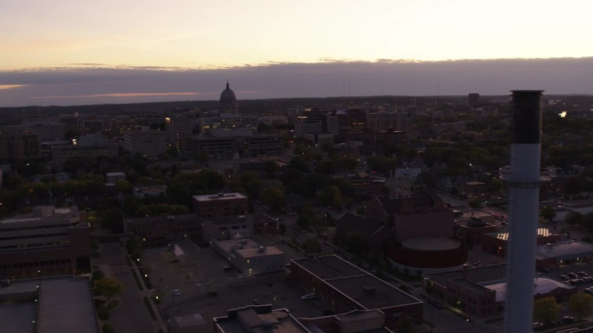 5.7K stock footage aerial video flyby capitol dome to reveal smoke stacks at twilight, Madison, Wisconsin Aerial Stock Footage | DX0002_162_020