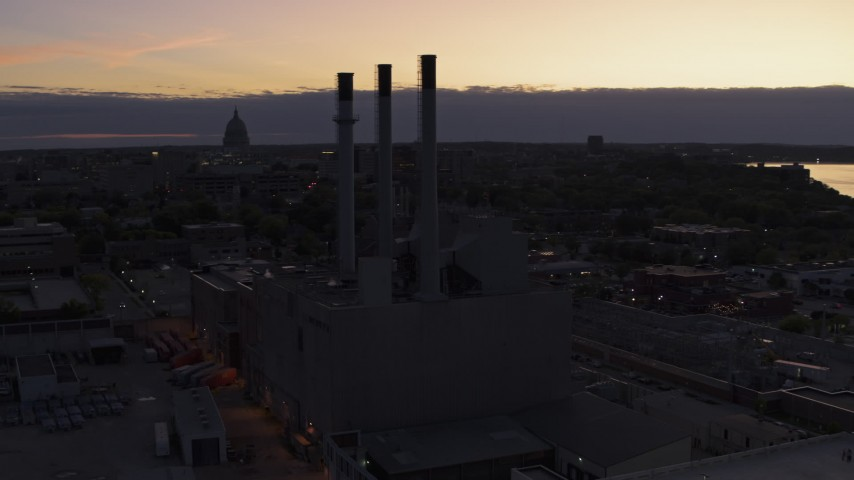 5.7K stock footage aerial video descend and orbit power plant smoke stacks at twilight, Madison, Wisconsin Aerial Stock Footage | DX0002_162_021