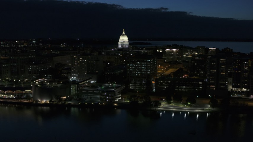 5.7K stock footage aerial video approach capitol dome from the lake at twilight, Madison, Wisconsin Aerial Stock Footage | DX0002_162_024