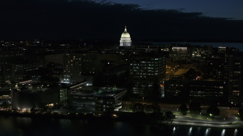 5.7K stock footage aerial video ascend away from capitol dome and downtown buildings at twilight, Madison, Wisconsin Aerial Stock Footage | DX0002_162_029