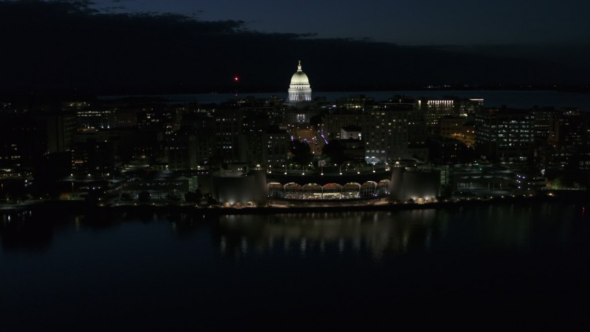 5.7K stock footage aerial video a reverse view of the capitol dome and convention center at night, Madison, Wisconsin Aerial Stock Footage | DX0002_162_031