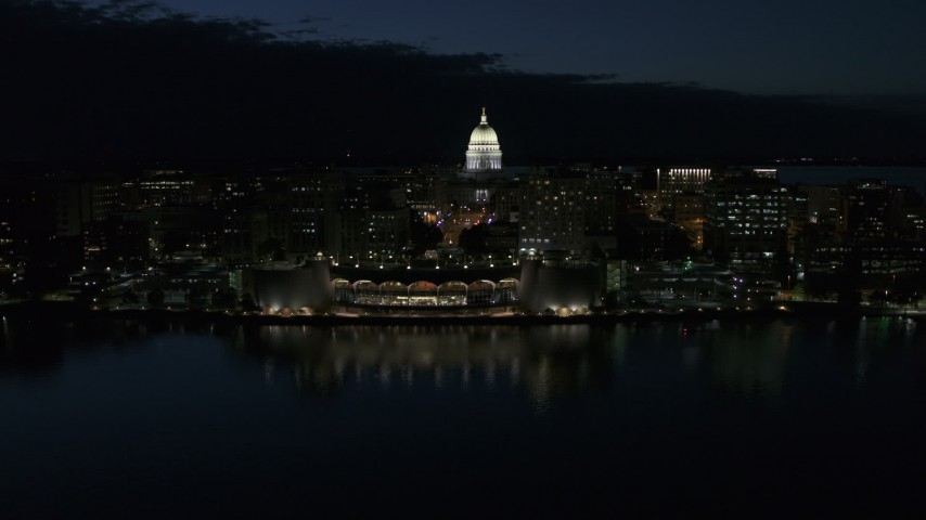 5.7K stock footage aerial video a stationary view and approach to the capitol dome and convention center at night, Madison, Wisconsin Aerial Stock Footage | DX0002_162_032