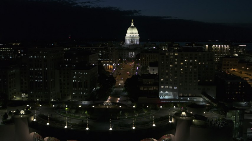 5.7K stock footage aerial video passing downtown buildings while focused on the capitol at night, Madison, Wisconsin Aerial Stock Footage | DX0002_162_034