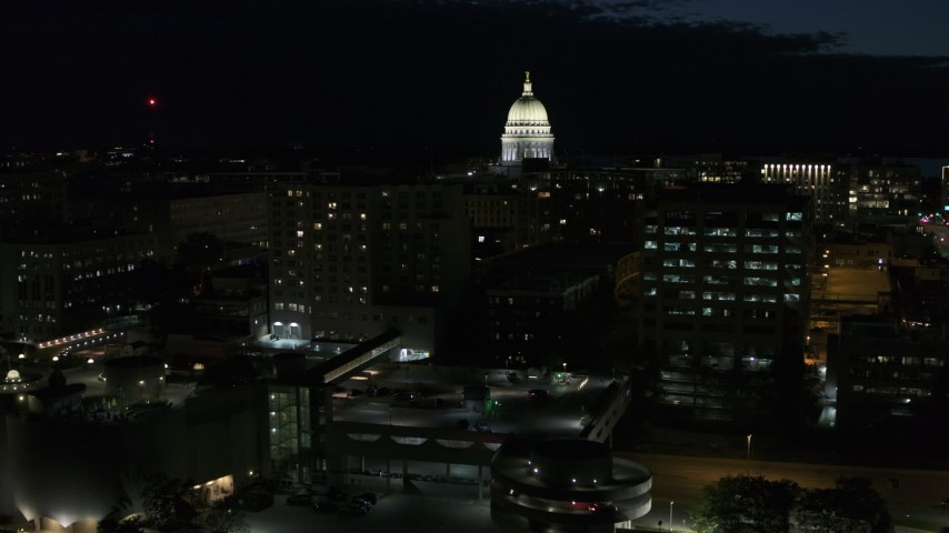 5.7K stock footage aerial video fly away from downtown buildings while focused on the capitol at night, Madison, Wisconsin Aerial Stock Footage | DX0002_162_035