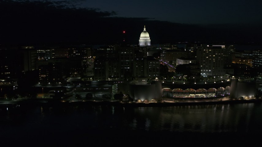 5.7K stock footage aerial video a reverse view of the capitol at night, reveal convention center, Madison, Wisconsin Aerial Stock Footage | DX0002_162_037