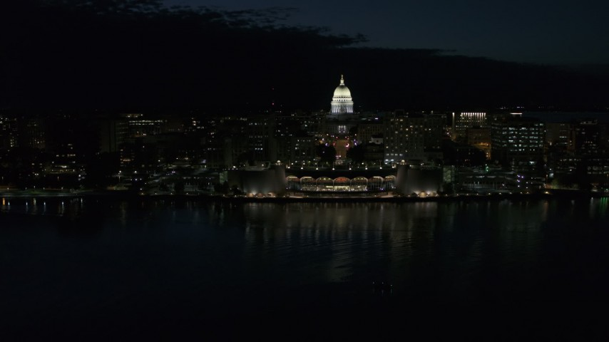 5.7K stock footage aerial video of flying away from the convention center and capitol in downtown at night, Madison, Wisconsin Aerial Stock Footage | DX0002_162_038