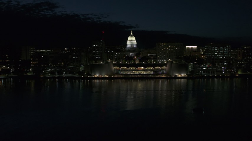 5.7K stock footage aerial video descend toward the convention center and capitol in downtown at night, Madison, Wisconsin Aerial Stock Footage | DX0002_162_039