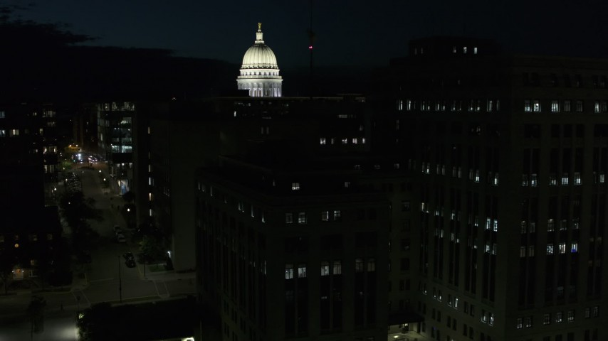 5.7K stock footage aerial video view of capitol dome while descending by building at night, Madison, Wisconsin Aerial Stock Footage | DX0002_162_041