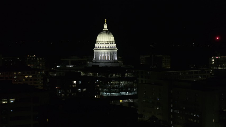 5.7K stock footage aerial video closely orbiting the capital dome at night, Madison, Wisconsin Aerial Stock Footage | DX0002_162_043