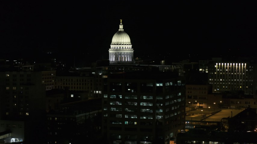 5.7K stock footage aerial video descend and fly away from the capital dome at night, Madison, Wisconsin Aerial Stock Footage | DX0002_162_045